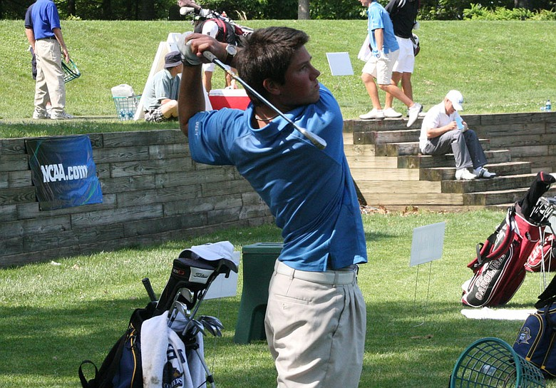 Rhys Enoch hits balls on the range at The Course at Yale after his second-round 68.