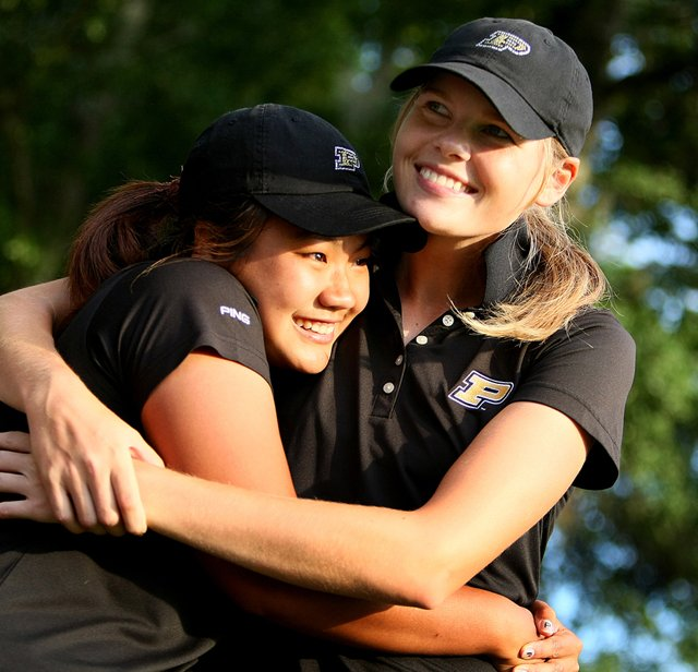 Purdue&#39;s Maude-Aimee LeBlanc (right) and Numa Gulyanamitta celebrate after winning the NCAA Women&#39;s Championship.