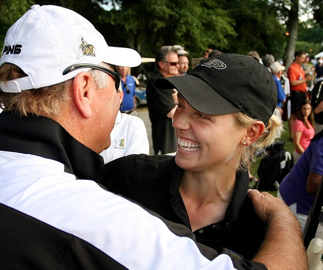 Purdue head coach Devon Brouse (left) hugs Thea Hoffmeister after winning the NCAA Women&#39;s Championship at the Country Club of Landfall. 