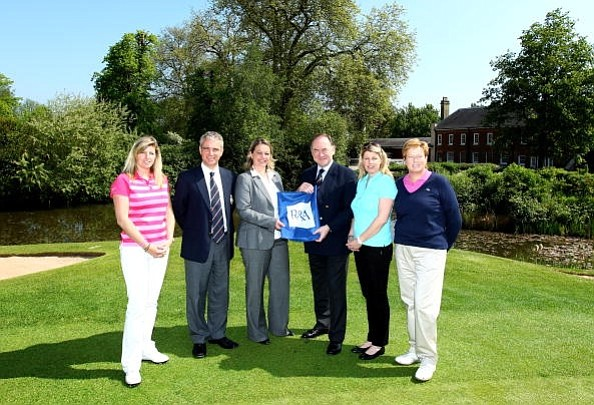 The R&A's Chief Executive Peter Dawson (right) and Director of Golf Development Duncan Weir presented tour players Johanna Mundy (from left), Samantha Head and Karen Lunn, along with LET Executive Director Alexandra Armas (middle), the Working for Golf flag at the Buckinghamshire Golf Club.
