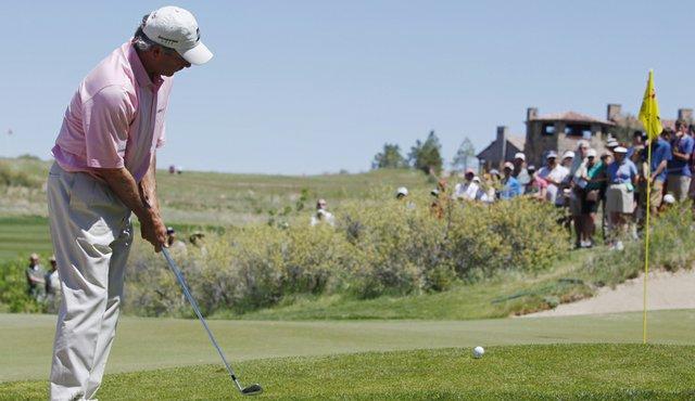 Fred Couples hits a chip shot at Colorado Golf Club during the 2010 Senior PGA Championship.