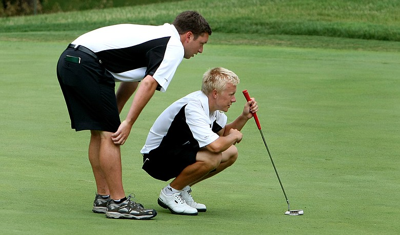 Baylor's interim assistant Ben Wright (left) Joakim Mikkelsen line up a putt during Round 1 at the NCAA Championship.