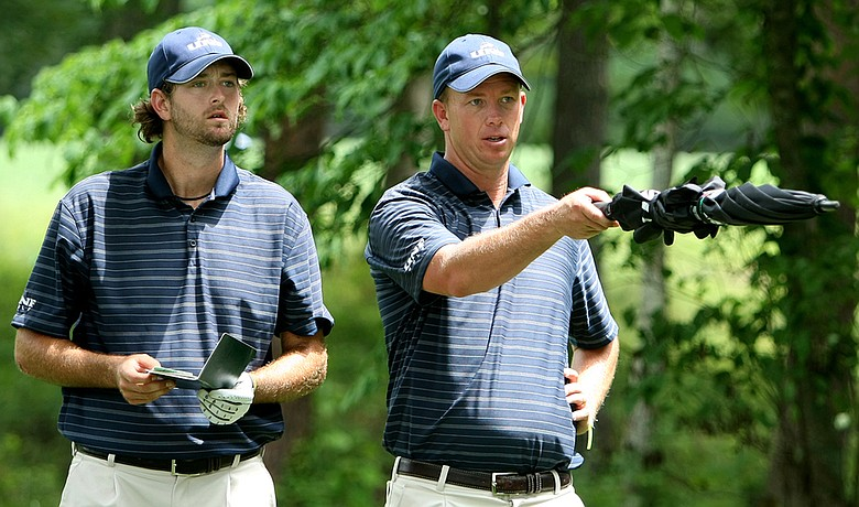 North Florida head coach Scott Schroeder (right) and J.C. during the first round of the NCAA Championship.