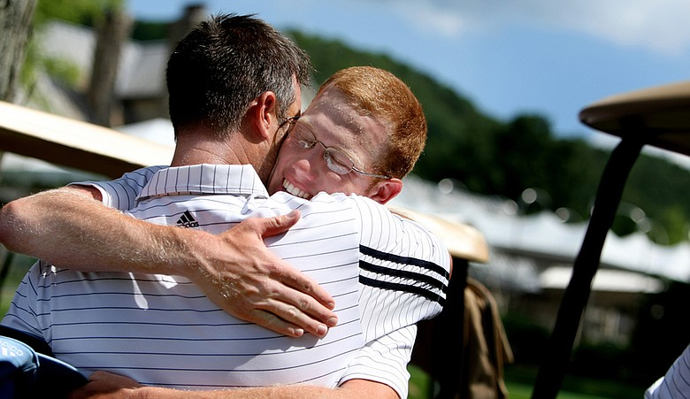 Augusta State's Carter Newman hugs head coach Josh Gregory after Saturday's semifinal win over Florida State.