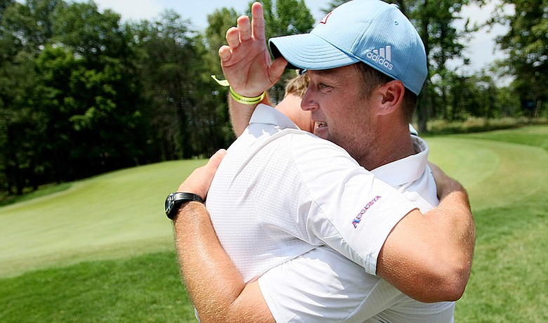 Augusta State head coach Josh Gregory and Henrik Norlander hug after winning the NCAA Championship on June 6.