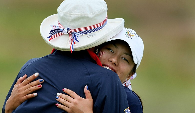 Stephanie Kono gets a hug from Team USA captain Noreen Mohler.