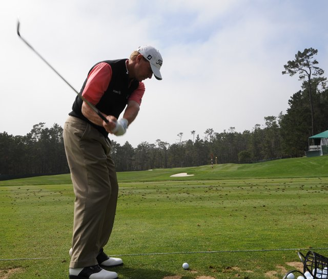 Steve Stricker hits balls at Pebble Beach on June 13.