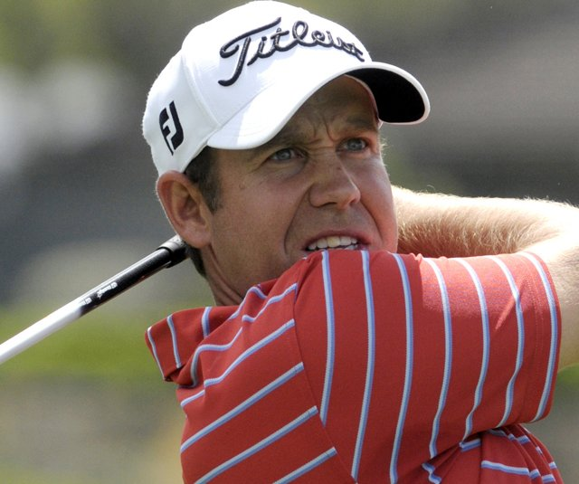 Erik Compton hits a shot at the Arnold Palmer Invitational. (File photo)