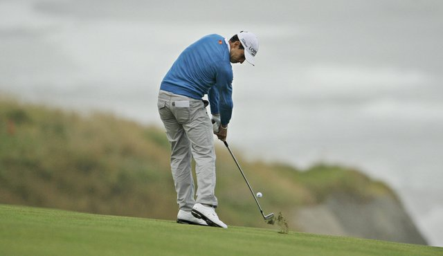 Rafael Cabrera-Bello hits into the 10th hole during the first round of the U.S. Open.