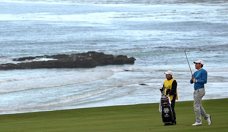 Rafael Cabrera-Bello hits his approach into the 10th hole Thursday at Pebble Beach.