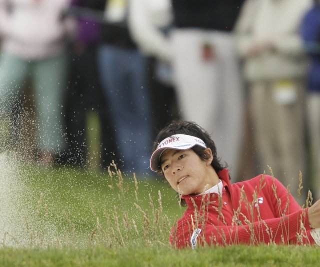 Ryo Ishikawa blasts out of a bunker on the 12th hole Friday at Pebble Beach. 
