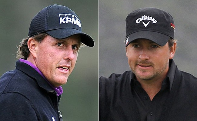 Phil Mickelson, left, shot a five-under 66 Friday to pull within two of leader Graeme McDowell.