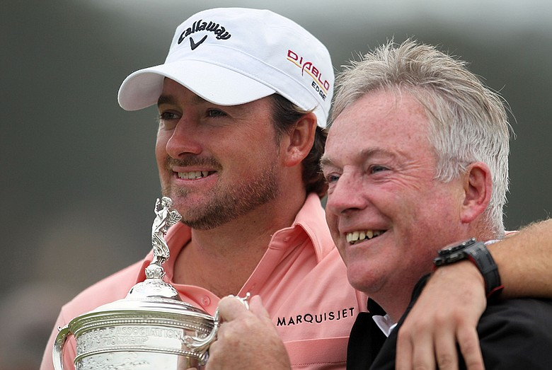 Graeme McDowell and his father, Kenny, celebrate a victory June 20 at the U.S. Open.