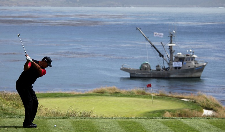 Tiger Woods hits to the seventh green during the final round of the U.S. Open.
