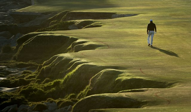 Phil Mickelson walks down the 18th fairway during the third round of the 2010 U.S. Open.