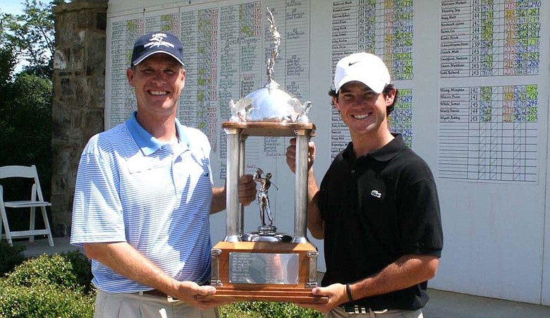 Brian Harman (right) accepts the trophy from tournament director Edward Toledano at the 2009 Dogwood Invitational.