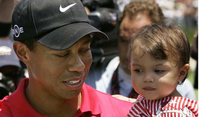 Tiger Woods holds his daughter, Sam, after winning the 2008 U.S. Open.