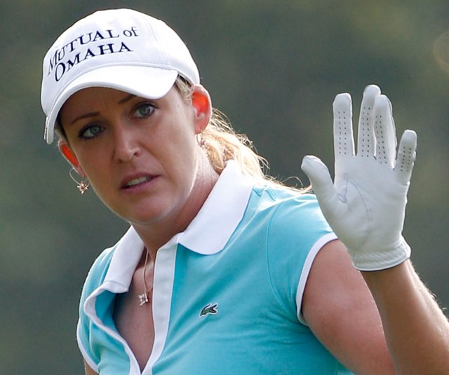 Cristie Kerr shot a second-round even-par 71 at Oakmont before storms moved into the area, suspending play.