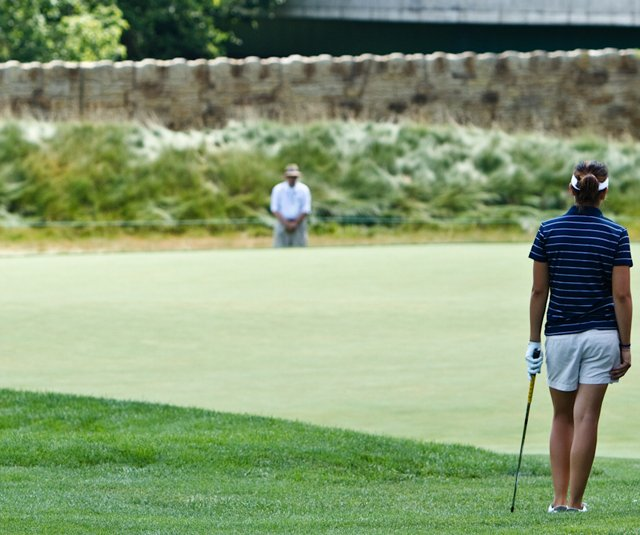 Lisa McCloskey and her caddie wait on the first hole Saturday at Oakmont.