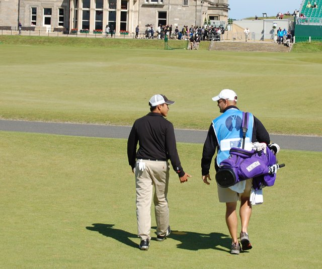 Northwestern junior Eric Chun and caddie Steve Bailey during a practice round at the British Open.