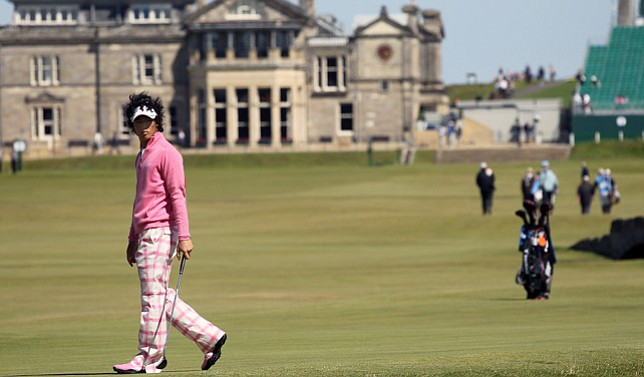 Japan's Ryo Ishikawa walks onto the 17th green at the Old Course in St. Andrews during a practice round at the 139th Open Championship.