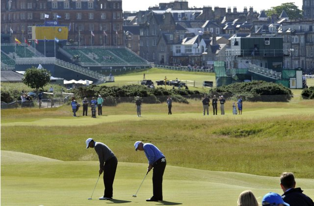 Tiger Woods and Mark O'Meara putt during a Monday practice round at St. Andrews.