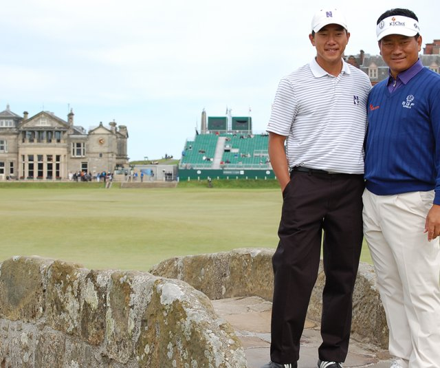 Eric Chun and K.J. Choi pose for a picture on the Swilcan Bridge Tuesday at the Old Course.