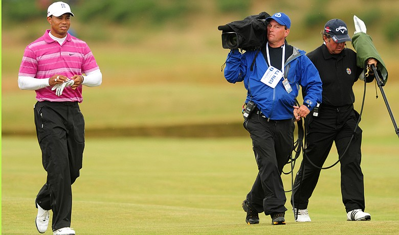 Tiger Woods is filmed by a film crew from ESPN during the first round of the the British Open.