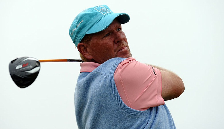 John Daly opened with a 6-under 66 on a calm day at St. Andrews.