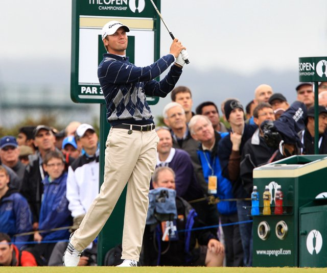 Sean O'Hair tees off on the 11th hole during the opening round of the British Open.