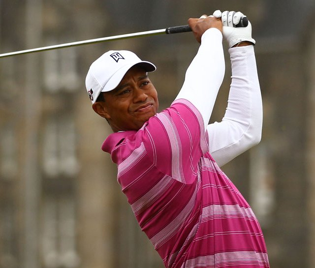 Tiger Woods tees off on the second hole during the first round of the British Open.