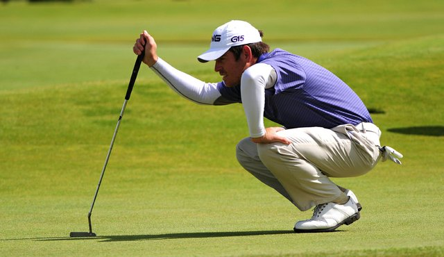 Louis Oosthuizen bends down to read a putt at the Old Course at St. Andrews.