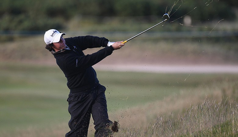 Rory McIlroy plays his second shot from an awkward lie on the 15th hole during the second round of the British Open.