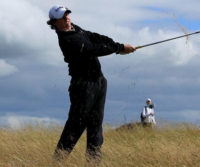 Rory McIlroy punches a shot under the wind during Round 2 of the British Open.