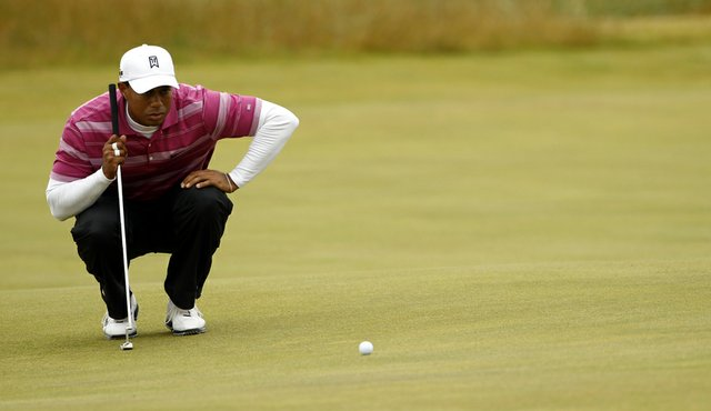 Tiger Woods lines up a putt during Round 1 of the British Open.
