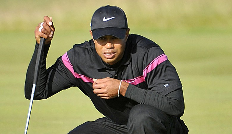 Tiger Woods reads a putt during Round 3 of the British Open.