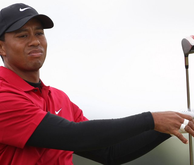 Tiger Woods watches his tee shot on the third tee during the final round of the British Open.