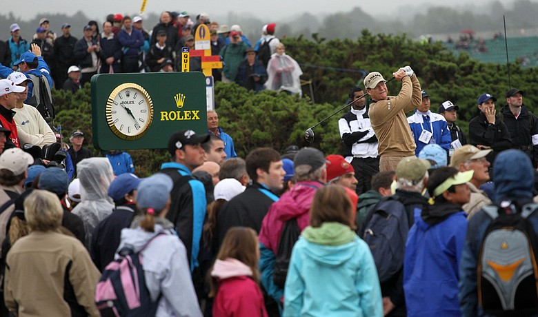 Tom Watson plays a shot from the fifth tee surrounded by spectators during the first round of the British Open.