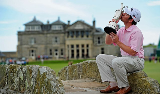 Louis Oosthuizen kisses the Claret Jug a day after winning the British Open.