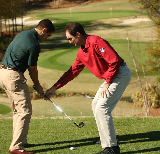 Charlie King (right) is the director of the Reynolds Plantation Golf Academy in Greensboro, Ga.
