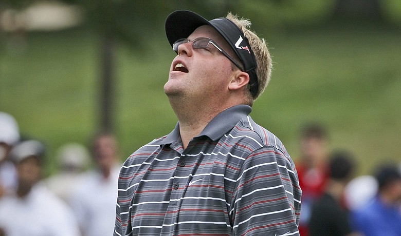 Carl Pettersson reacts as his putt misses the cup on the 18th green during the third round of the Canadian Open.