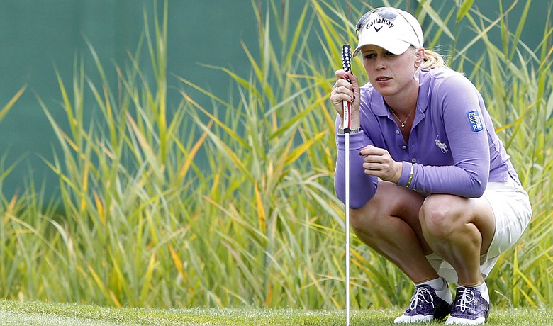 Morgan Pressel studies a putt on the fifth hole during the third round of the Evian Masters.