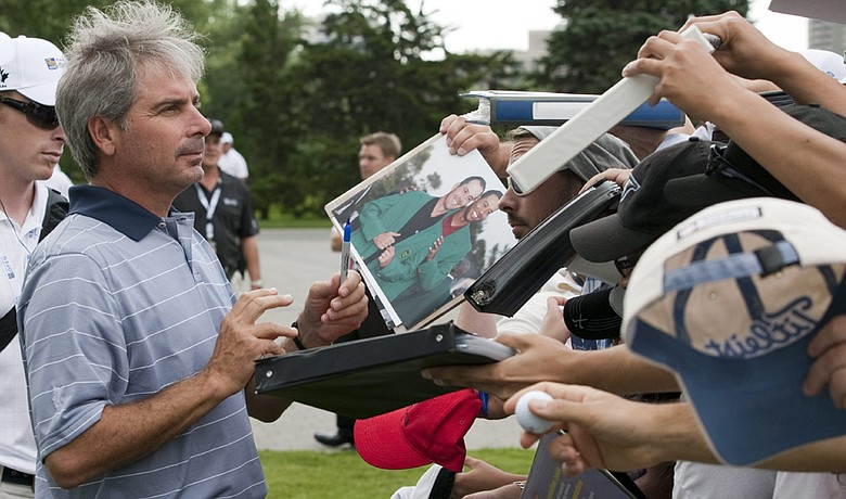 Fred Couples signs autographs at the U.S. Senior Open.