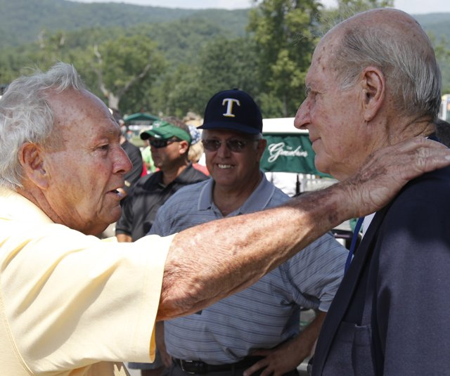Arnold Palmer chats with Bill Campbell during the first round of the Greenbrier Classic.