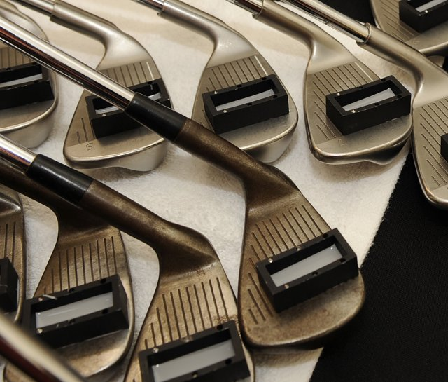 The USGA tests clubs for conforming grooves before the 2009 Children's Miracle Network Classic.