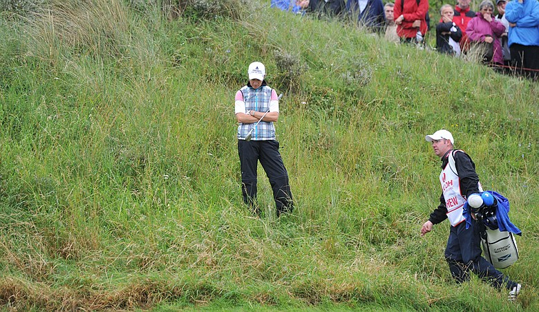 Defending champion Catriona Matthew looks at an unplayable lie at the 13th hole at Royal Birkdale.