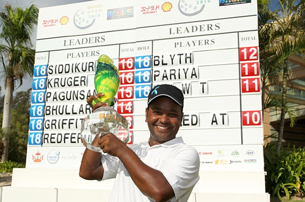 Siddikur Rahman of Bangladesh with the Brunei Open trophy.