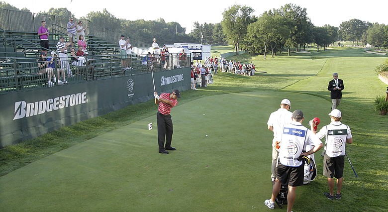 Tiger Woods has only a small gallery as he takes a practice swing before teeing off in the fourth round of the Bridgestone Invitational.