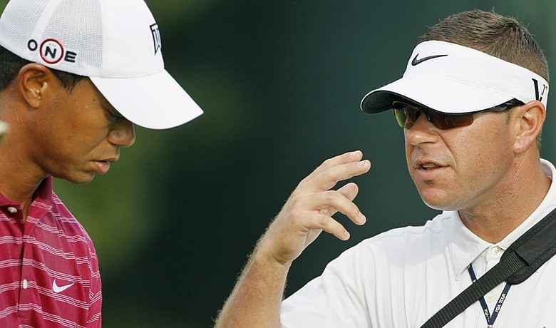 Tiger Woods and Sean Foley talk Aug. 10 at the PGA Championship.