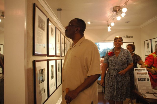 A visitor admires Hannibal Square Heritage Center's new exhibit, which tells the story of west side Winter Park and the everyday people who made a big difference in the city.